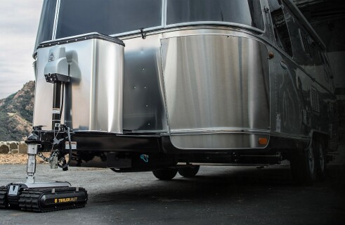 "A mini-robot from the company ""Trailer Valet"" acts as a tractor for a trailer"