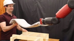 A man and a robot work together: what does it look like?