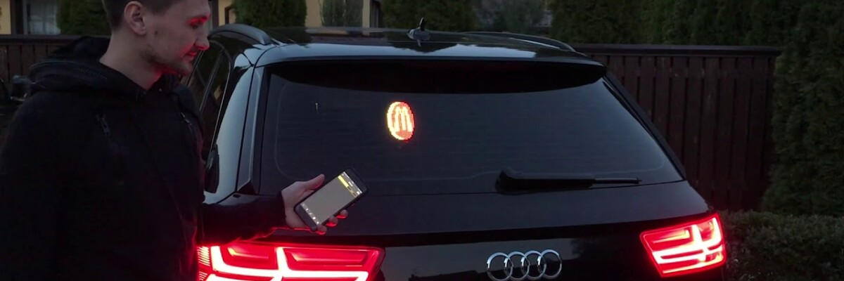 Like stickers in the back window of your car? This device will make them a thing of the past!